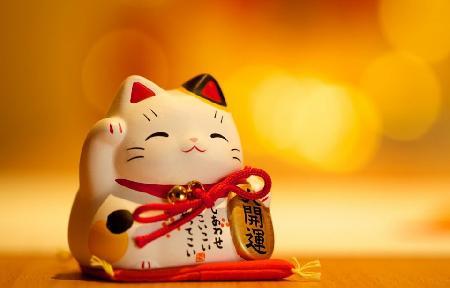 Con mèo Maneki neko - chú mèo vẫy tay